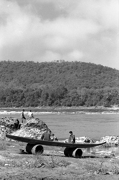 Two persons sitting on landed boat