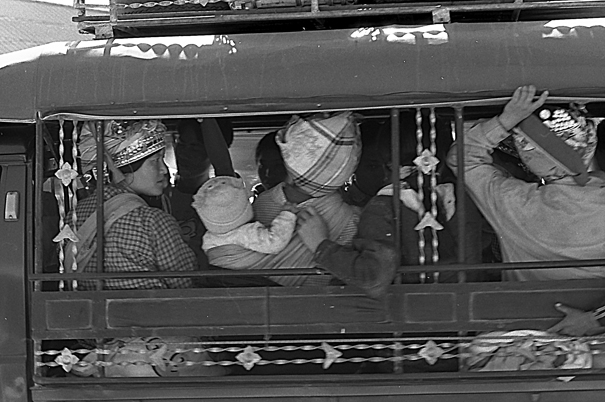 Ethnic Minorities On The Carrier (Laos)
