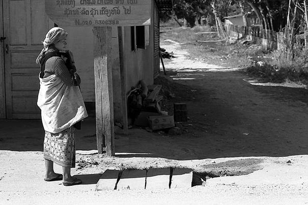 Akha Woman Standing By The Roadside (Laos)