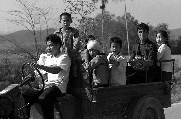 People On The Luggage Carrier Of The Tractor (Laos)