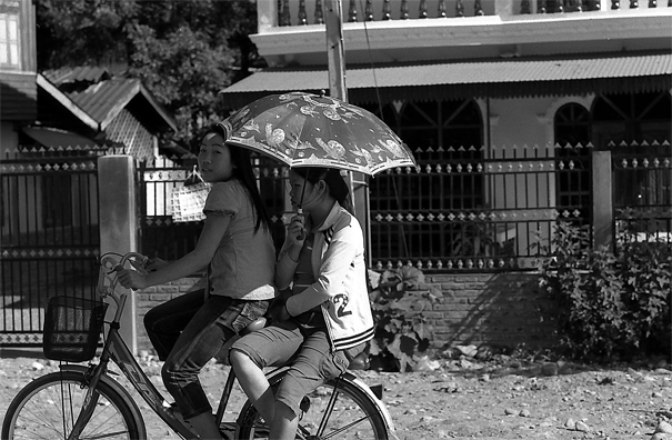 Two Girls On The Same Bicycle (Laos)
