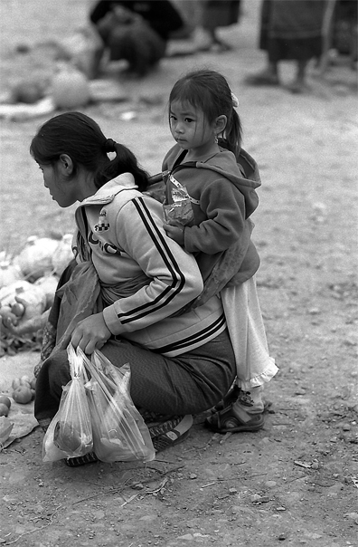 Girl cuddling up to her mother