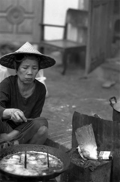 Woman Wearing A Conical Hat Was Frying @ Laos