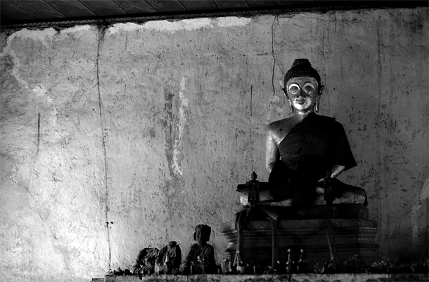 Some Buddha statues in dim hall