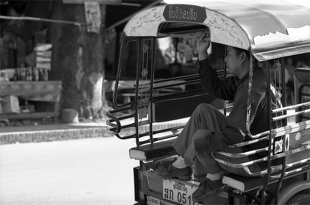 Man On The Seat Of A Jumbo @ Laos