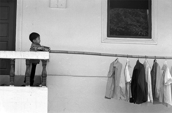 Boy playing veranda with laundries