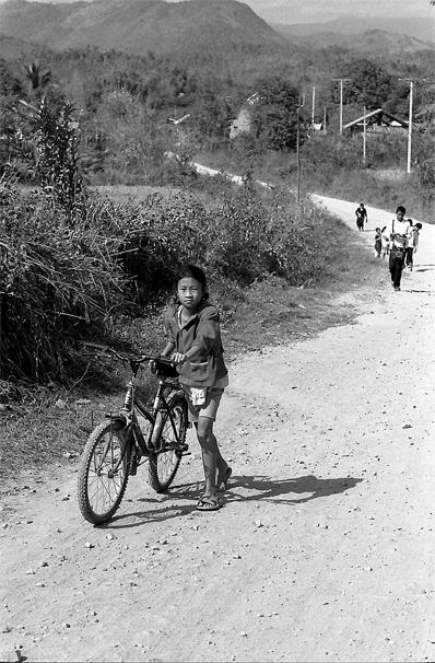 Girl Walking Her Bicycle @ Laos