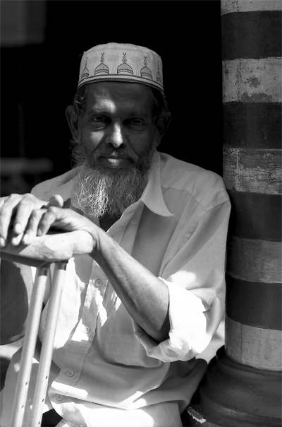 Man Resting In Jami Ul-Alfar Mosque (Sri Lanka)