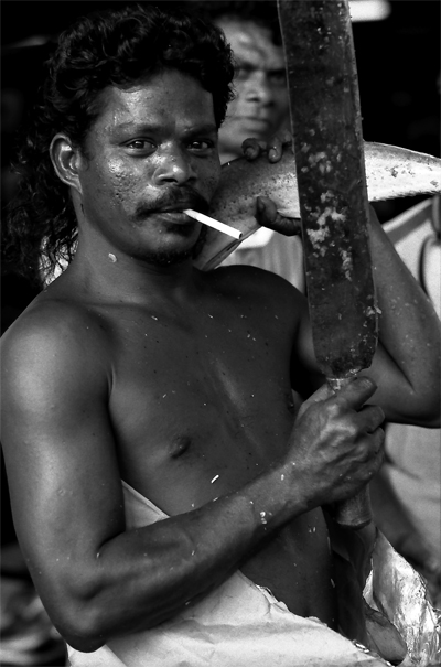 Muscle-bound Man With A Cigarette And A Knife (Sri Lanka)