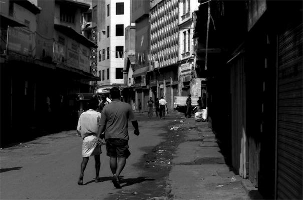 Men Walking The Street In Pettah (Sri Lanka)