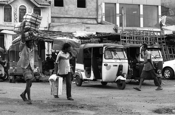 Men Walking The Street With Burdens (Sri Lanka)