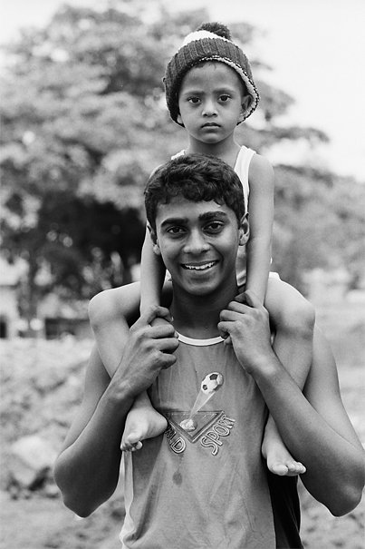 Boy with a sulky face on shoulder