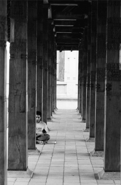 Young Man Sitting Among Columns @ Sri Lanka