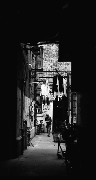 Figure At The Bottom Of The Alleyway @ China