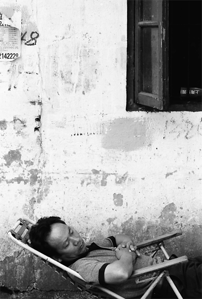 Man Napping In The Lane (China)