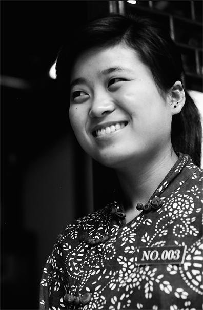 She Smiles Bashfully (China)