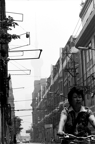 Woman Sprinting Between Buildings @ China