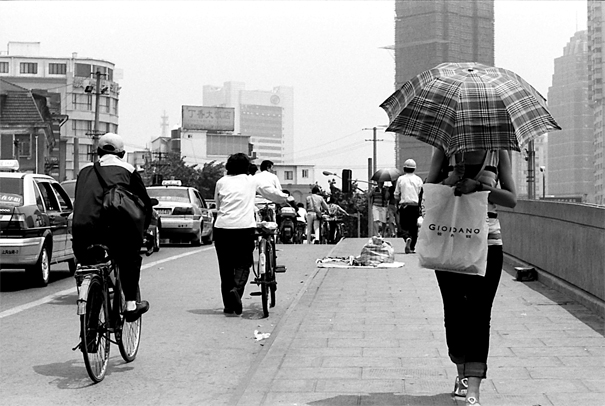 Umbrella Walking On The Bridge (China)