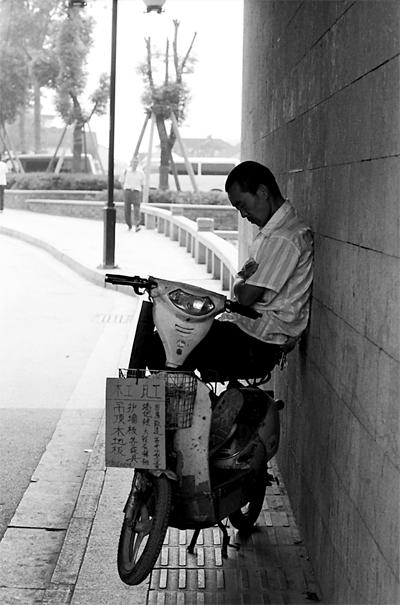 Man Napping In The Shade @ China