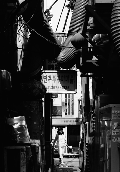 Woman In The Lane Under Hoses (South Korea)