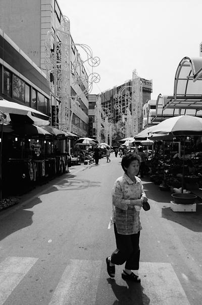 Woman Making A Trip To The Fish Market (South Korea)