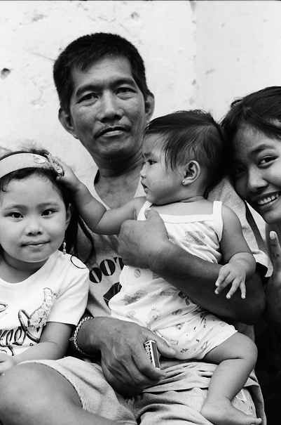 Family Relaxig By The Roadside (Philippines)