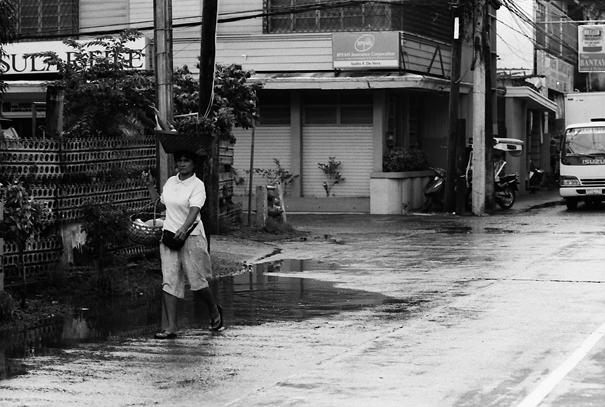 Woman walking with basket on head