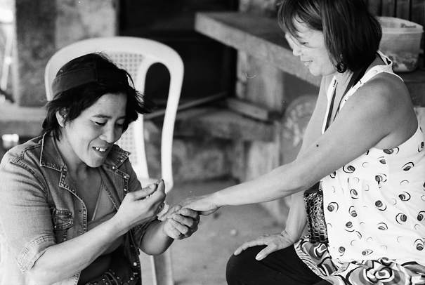 Woman getting her nails done by roadside