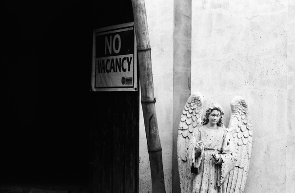 Angel standing at entrance