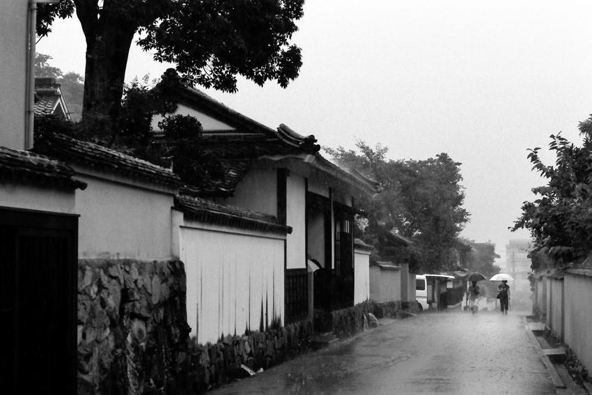 Two umbrellas in hard rain