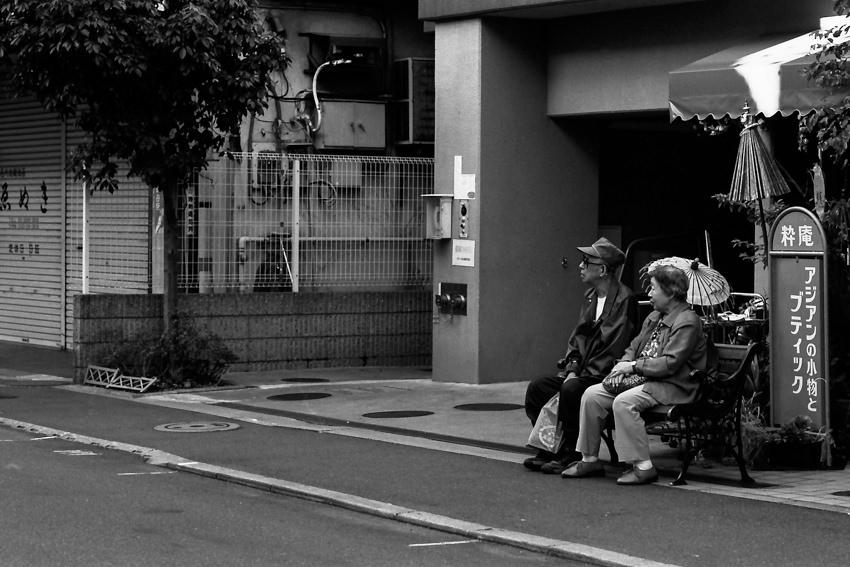 Older couple sitting on bench