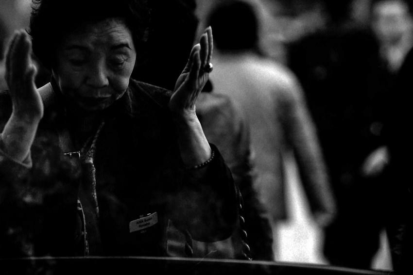 Woman basking smoke in temple