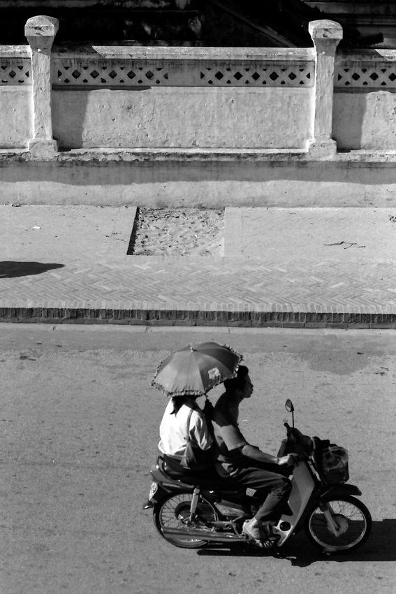 Umbrella on motorbike