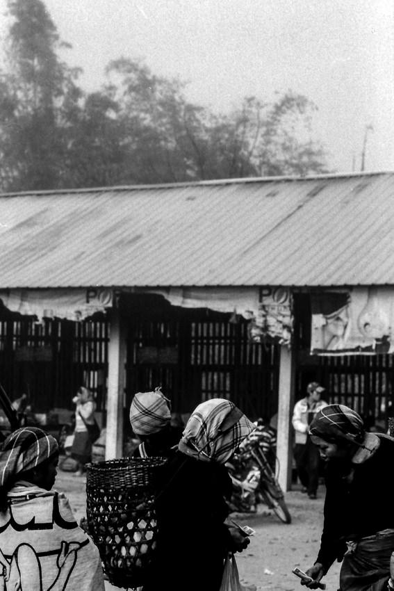 Akha women in market in Muang Sing