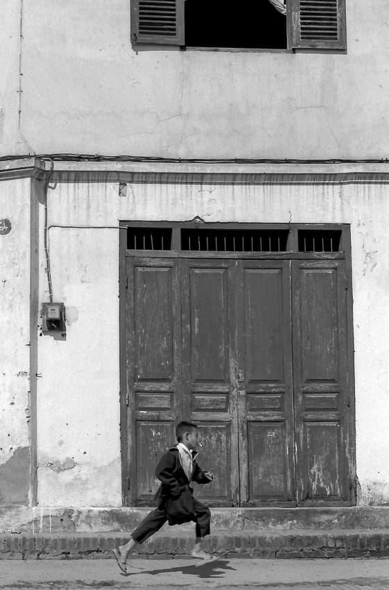 Boy running in front of door