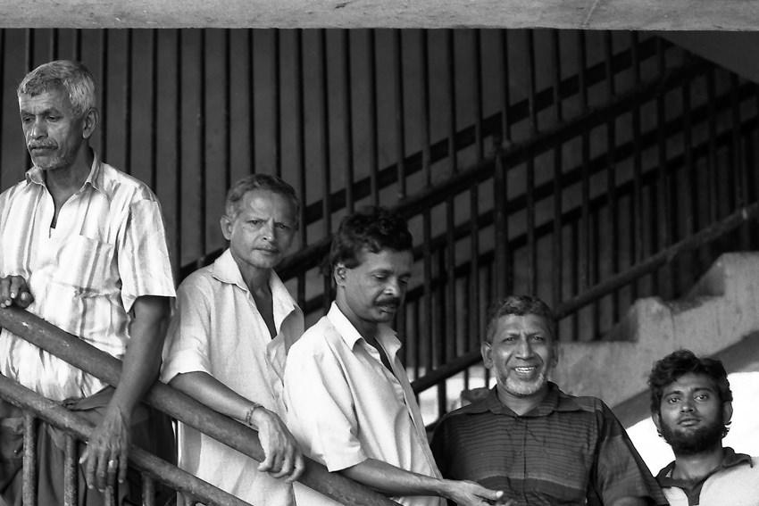 Men standing on stairway