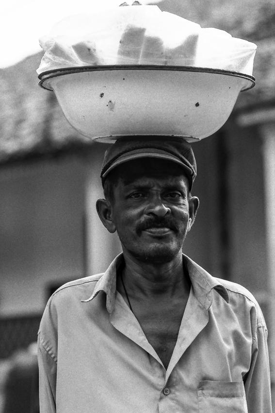 Man putting bowl on head