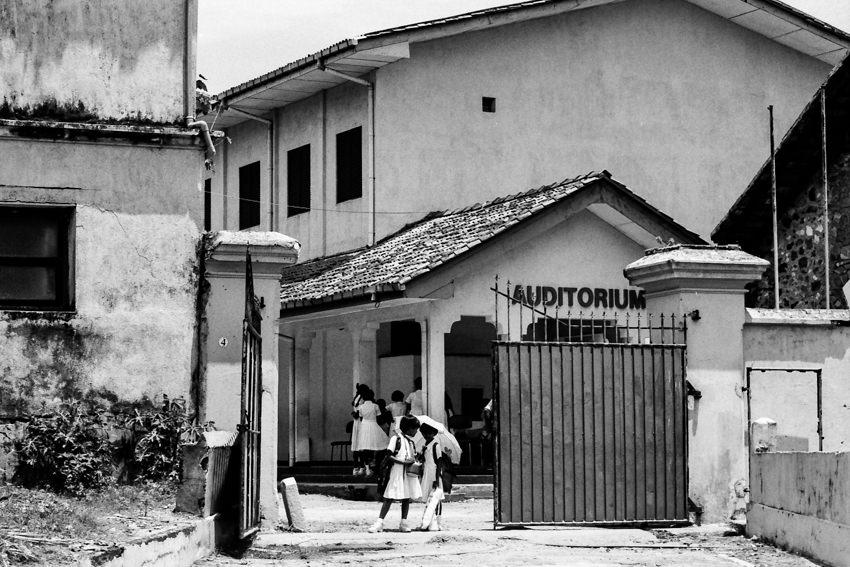School girls standing at school gate