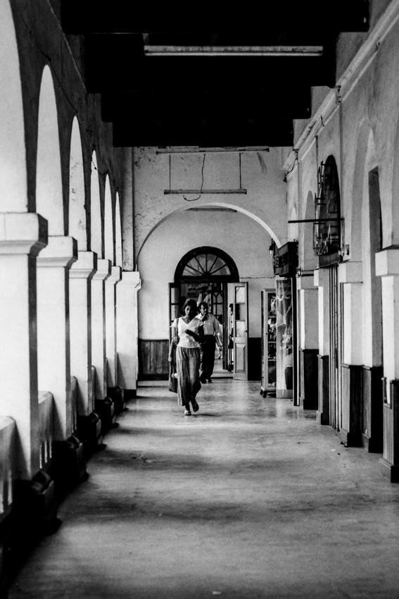 Woman walking passage