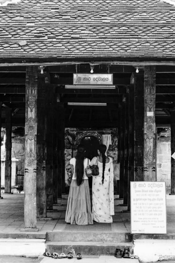 Two women praying in Natha Devale