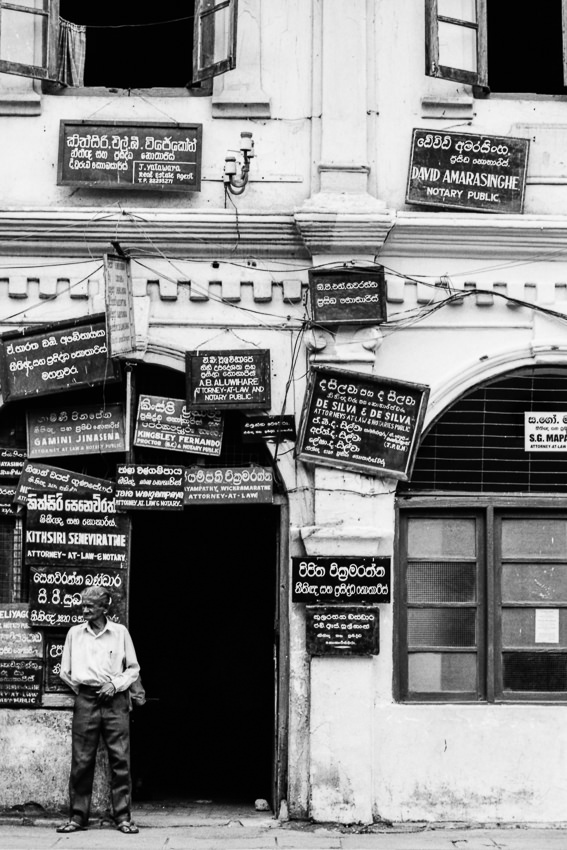 Many signboards hung on the wall