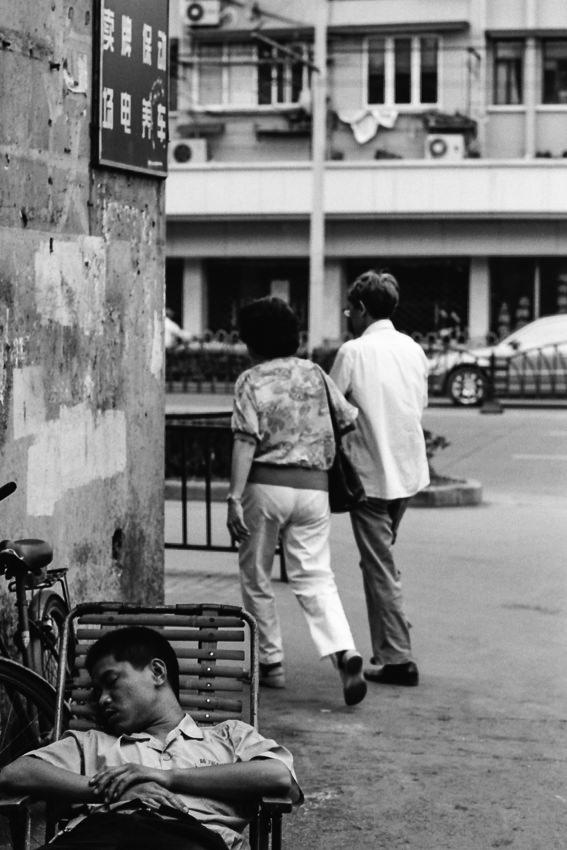 Man taking nap in street corner