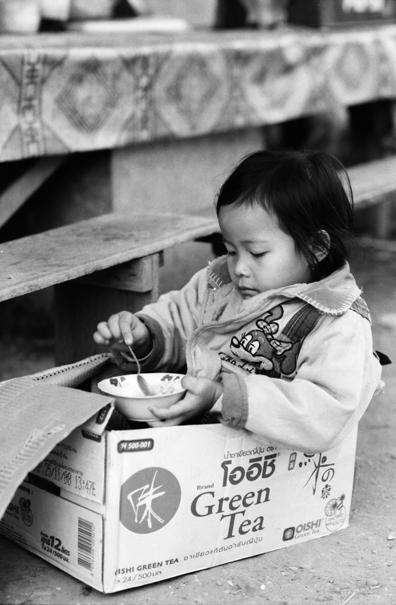 Girl In The Cardboard Box (Laos)