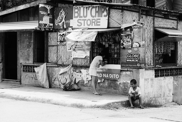 Woman And Boy In Front Of A Store @ Philippines
