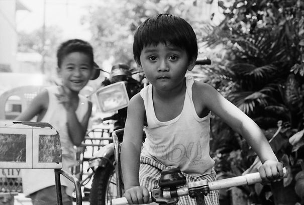 Boy Playing On The Bicycle (Philippines)