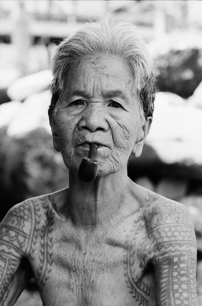 Older Woman With A Pipe In Her Mouth (Philippines)