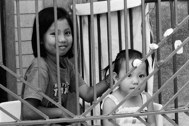 Two Girls On The Other Side Of The Fence (Philippines)
