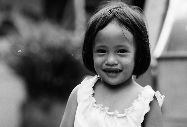 Little girl smiling in an innocent way