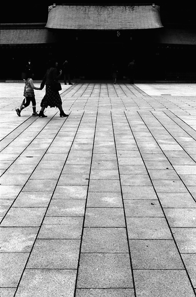 Figures Walking The Precinct (Tokyo)