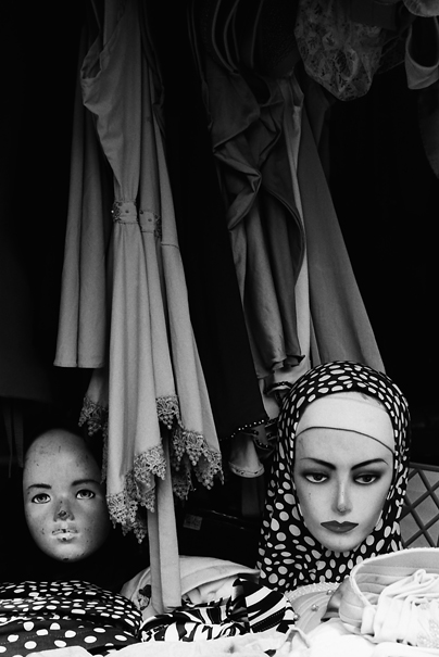 two faces of mannequin in storefront